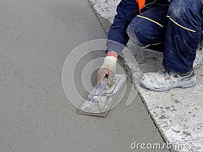 Mason concludes edge of the concrete surface