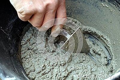 Mason preparing cement