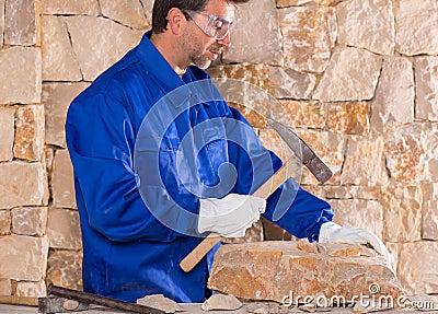Masonry mason stonecutter man with hammer working