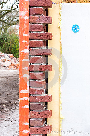 Masonry wall with cavity wall insulation Stock Photo
