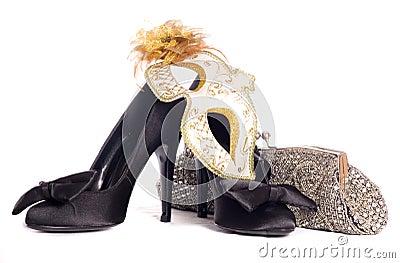 Masquerade mask with high heel shoes and handbag