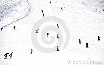 Mass descent of mountain skiers  from hillside