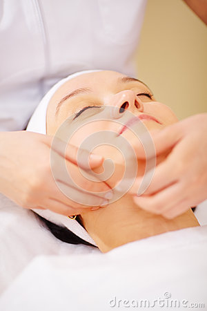 Massage of face at beauty treatment salon stock photo for A trial beauty treatment salon
