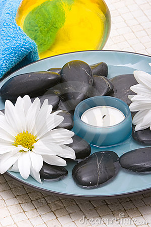 Massage stones and candle