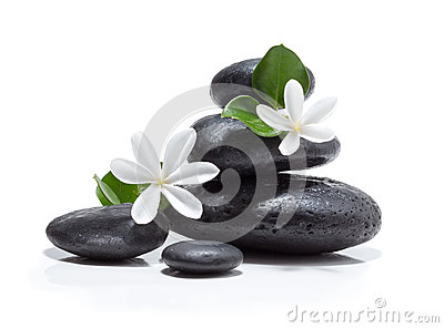 Massage tiare flowers, candle and black stone spa