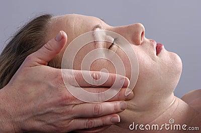 Massaging Face at Spa