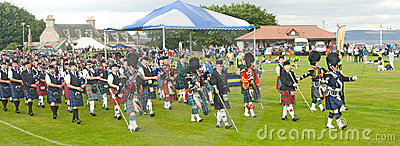 Massed Pipe bands marching at Nairn. Editorial Photography