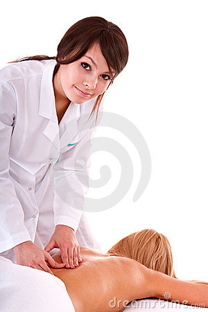 Masseur beautician does massage in spa salon.