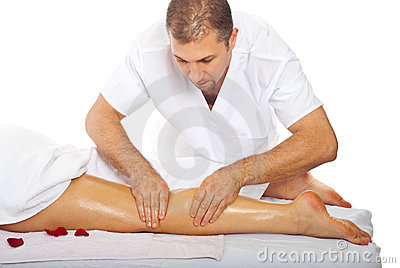 Masseur giving anti cellulite leg massage