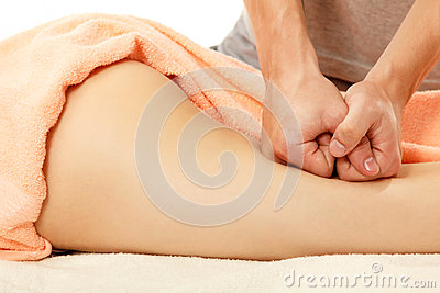 Masseur makes anticellulite massage young woman isolated on whit