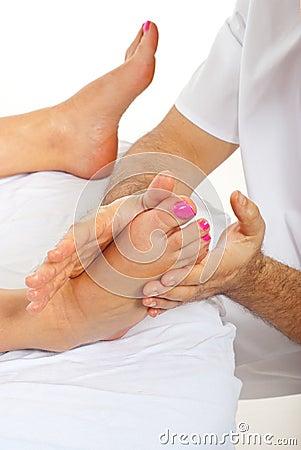Masseur massaging woman feet