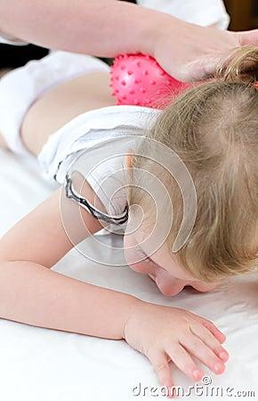 Masseuse doing massage