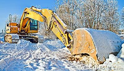 Massive bulldozer, work stopped for winter