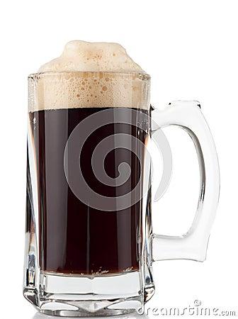 Glass pitcher of dark beer