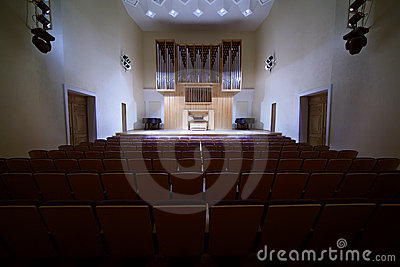 Massive pipe organ in empty concert hall