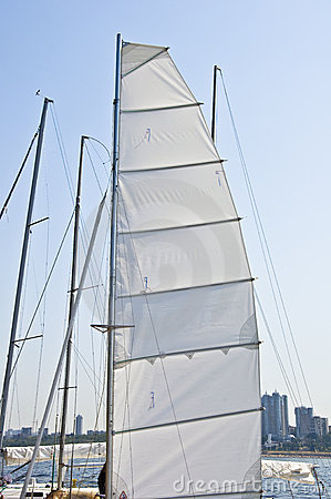 Mast yacht with a sail.