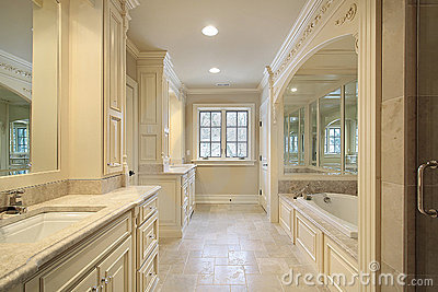 Suzie Milton Development Master Bathroom With Wood Paneled Drop Tub Flanked By Cabinets