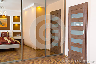 Master bedroom interior with mirrors