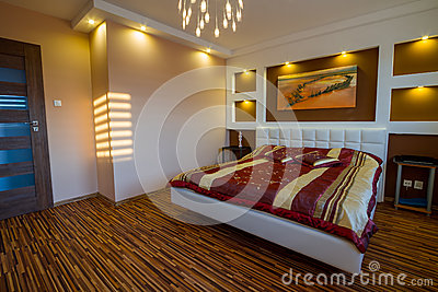 Master bedroom interior with spotlights