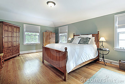 Master bedroom with oak wood furniture
