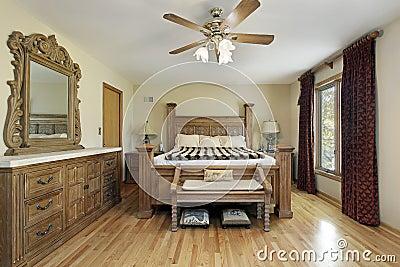 Master bedroom with oak wood furniture