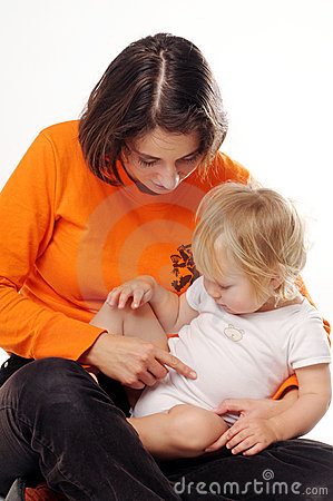 Mather in orange T-shirt with little blonde girl