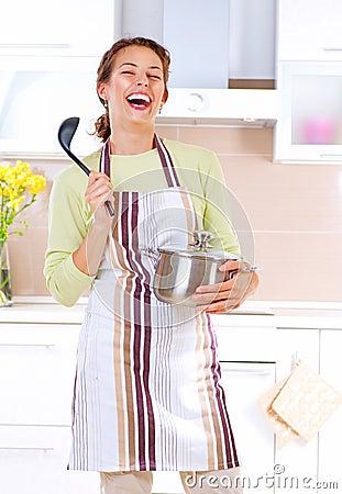 Matlagningkvinnabarn