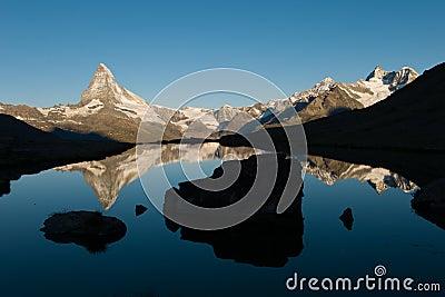 Matterhorn Reflection In Stellisee At Sunrise