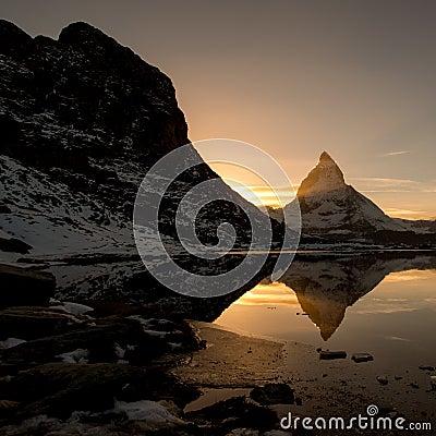 Matterhorn from Riffelsee mountain lake above Zermatt
