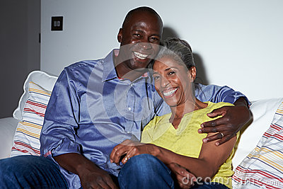 Mature African American Couple On Sofa Watching TV Together