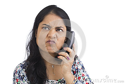 Mature Asian Woman annoyed and frustrated at unwanted Phone calls