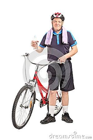 Mature biker holding a water bottle