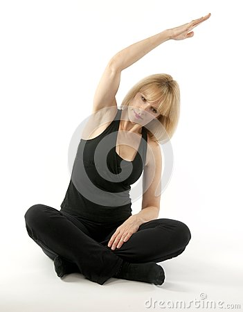Mature blond woman doing yoga stretching exercise