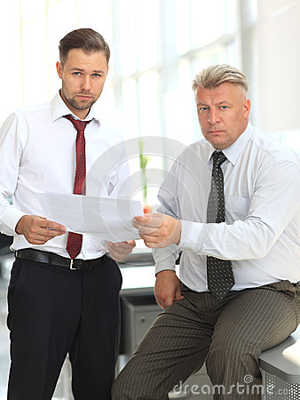 Mature business man discussing with his colleague