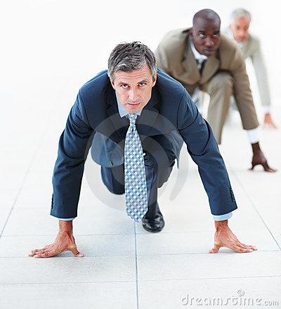 Mature business man in position for a race