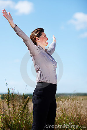Mature business woman with arms outstretched