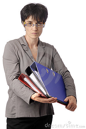 Mature business woman looking over her glasses
