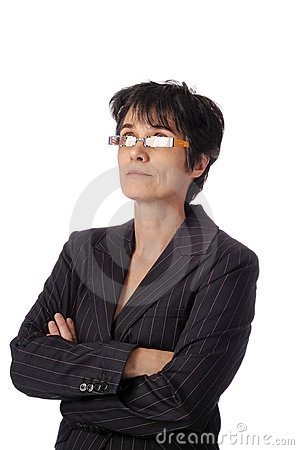 Mature business woman looking up over her glasses