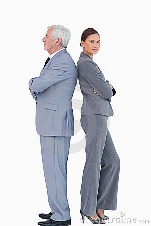 Mature businessman back to back with colleague