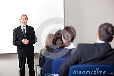 Mature businessman giving business training
