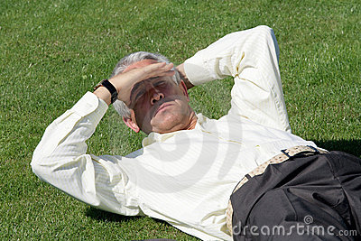 Mature businessman on grass