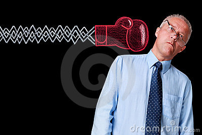 Mature businessman knockout punch
