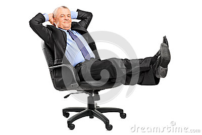 Mature businessman resting in armchair