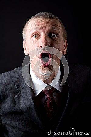 Businessman screaming at camera