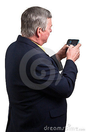 Mature businessman sending text message