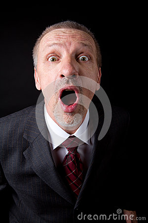 Mature businessman shouting at camera
