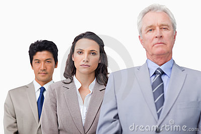Mature businessman standing with colleagues