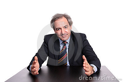 Mature businessman at table