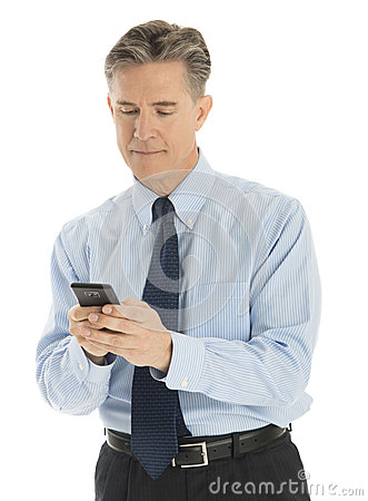 Mature Businessman Text Messaging Through Mobile Phone