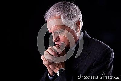 Mature businessman, thinking-praying
